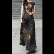 فستان أسود كت منفوش بنقوش ذهبية لامعة