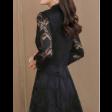 فستان دانتيل أسود بياقة مرتفعة