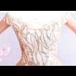 فستان اللمعة الذهبية المنفوش