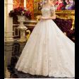 فستان زفاف أبيض بتطريز ذهبي أنيق